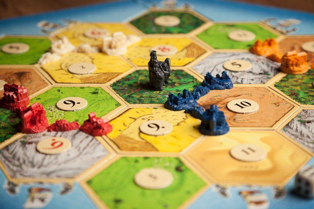 Catan, juegos de mesa para mejorar la socialización
